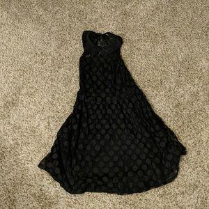 Black polka dot sleeveless dress